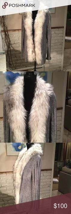 Sweater This is absolutely STUNNING! I wouldn't be selling it if it wasn't too big for me. it's in perfect condition! Someone should enjoy this  gorgeous shade of grey, stunning faux fur trim. Feels sooo good on. No offers. Firm on the price. chicos Sweaters Cardigans