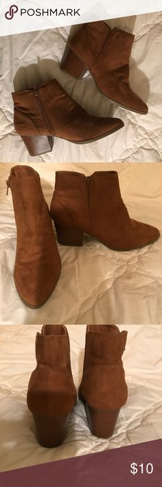 Never worn brown short boots Short brown boots can be dressed up or down for a casual look! Forever 21 Shoes Ankle Boots & Booties