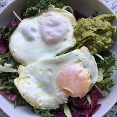 """Breakfast salad today! Lettuce mix from Costco (shredded brussel sprouts, cabbage, kale and broccoli) topped with wholly guacamole and two runny eggs!"" Photo taken by @morganswholelife on Instagram, pinned via the InstaPin iOS App! http://www.instapinapp.com (03/06/2015)"