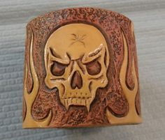 Leather Tooled Skull and Flames Bracelet by SouthPawArt on Etsy, $50.00