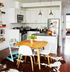 Our Brooklyn Apartment | A Cup of Jo | Stokke Tripp Trapp High Chair in Aqua Blue