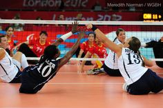 Kari Miller and a teammate go for a block at the 2012 London Paralympic Games