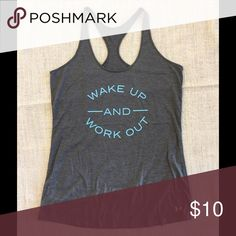 Gray under amour work out tank Wake up and work out racer back tank. Size medium, no inside size tag. Under Armour Tops Tank Tops