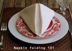 How to Fold a Dinner Napkin   -   The Pyramid Fold    -   http://noblepig.com/2013/03/fancy-dinner-napkin-folding-the-pyramid-fold/
