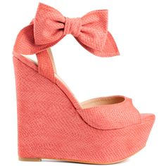 Bows are all the rage! You'll be able to rock the trend in this Penny Loves Kenny style. Dwight comes together with a coral faux croc textured upper and 2 inch platform. A big lovable bow is placed at the side to give you a feminine edge and a 6 1/4 inch wedge brings you a lift of courage.