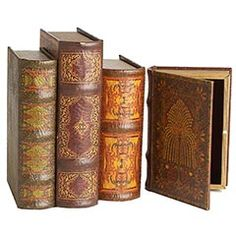 """Book boxes, Pier 1, $12-$14. The look of an old edition on the outside. A convenient spot to hold remotes on the inside.  Now that's book smart. Stack them on a table or shelf. Available in four sizes. Each sold separately.  Size:   5.75""""W x 1.75""""D x 8.25""""H"""