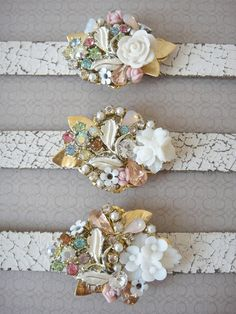 Repurposed jewelry, buttons, and watch band into corsages or bracelets.