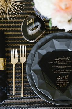So chic! Black geometric plats and diamond shaped menu card with gold cutlery and napkin ring #tablescape #gold #goldwedding #reception #black  // Glamorous Urban Boho Luxe Art Deco Gold Wedding Ideas and Inspiration