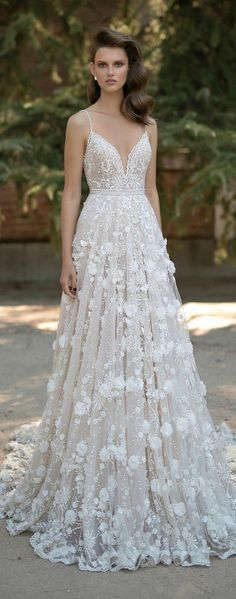 Looking for an outstanding dress for your wedding? Check out this stunning lace dress! You will look drop dead gorgeous. The delicate detailing covering the entire dress is remarkable. For more wedding dress inspo, check out our board.