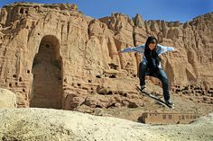 Credit: Skateistan Former volunteer and Skateistan's current fundraising manager, Erika Kinast, ollies in front of the Buddhas of Bamiyan, destroyed by the Taliban in 2001
