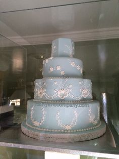 Light blue wedding cake with white piping.