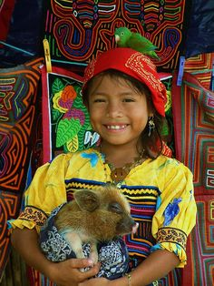 Kuna Indians in San Blas, Panama.  The women sell their Molas, intricate embroidery, and rule the roost.  A matriarchal society.