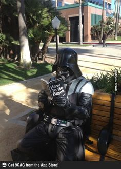 "Darth Vader reading ""How To Be Black""."