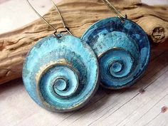 Tide Pool Earrings by Heather Torre | technique: chasing & repousse
