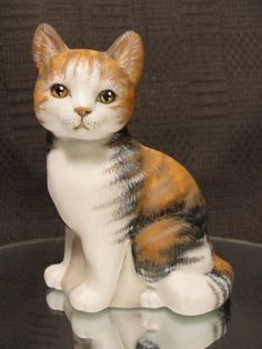 Fenton OOAK Sitting Cat Natural Calico Tabby. Sold on Ebay for $629.50 on 1-23-2015. Artist:  CC Hardman