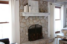 Paint stone fireplace with diluted Annie Sloan chalk paint in Paris gray.  Add white house paint if needed to lighten up.