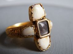 Transcendental One-of-a-Kind Victorian Braided Hair and Milk Teeth Gold Mourning Ring. $7,499.00, via Etsy.