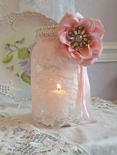 Ordinary glass jar makeover with lace & silk flower brooch.