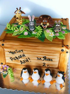 """Madagascar cake by bubolinkata, via Flickr. Since we like kids movies and he's been in Africa!  Maybe have the characters wear little leis, and """"welcome home"""" in scrabble letters"""