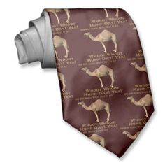 Hump Day tie. Brown color office humor tie.Hump Day is the middle of a work week (Wednesday); used in the context of climbing a proverbial hill to get through a tough week.