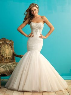 Style 9258 Layers of soft English net tuck throughout the entire bodice and are accented by crystalline beading across the bodice.