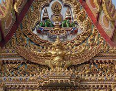 2010 Photograph, Wat Hua Lamphong ornate Gable of the Ubosot, Bangrak, Bangkok, Thailand. © 2011.  ภาพถ่าย ๒๕๕๓ วัดหัวลำโพงหน้าจั่วด้านหน้าอุโบสถ บางรักกรุงเทพประเทศไทย  The elephants and the tiered umbrellas of presence indicate that this is a Royal Wat.
