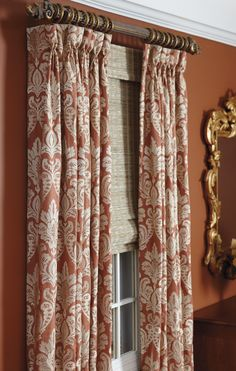 A casual woven shade gets a formal education from damask and burnished hardware.