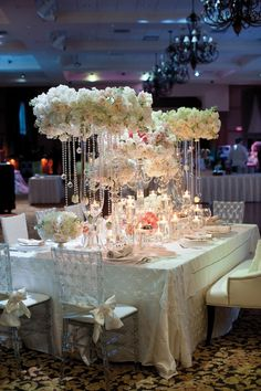 normally don't like chair covers but love these! love centerpieces but def can't see other people on other side of table.