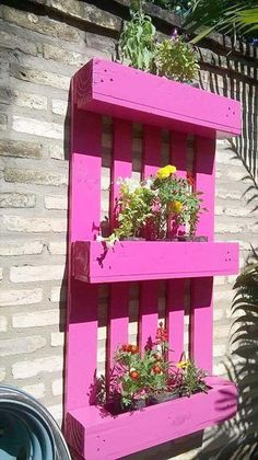 Pallet Recycled Planters And this could be called a whole package. This is not mere a planter, but this is a wooden pallet recycled planter cum vertical garden.