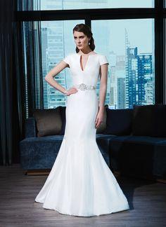 Justin Alexander signature wedding dress.  Silk dupion fit and flare dress accentuated by a notch neckline.