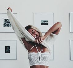 A beautiful face wearing pretty lace bra