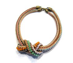 Uncovet knotted rope necklace. should be the icovet.  love a look of jeans a great white shirt and statement necklace with great sandals
