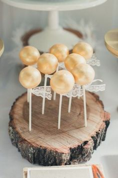 Golden shimmer cake pops at a Wedding Reception - I love the lace!!