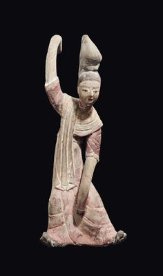 A painted pottery figure of a dancer, China, Tang Dynasty (618-906)