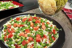 Sandi's surprise dip Makes: 3 dinner plates (dip), per plate (toppings) Ingredients for the dip: 1 250 g package light cream cheese 2/3 cup fat-free sour cream 1/4 cup light mayonnaise Ingredients for the topping: 3/4 cup chunky salsa (heat of your choice) 1 cup sharp cheddar cheese, grated 1/3 green pepper, diced 1-2 Roma tomatoes, diced 2 green onions, finely chopped