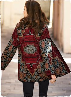 Elaborate patterning from an antique Persian carpet is replicated in rich oriental rug hues of crimson, chambray, black and clay.
