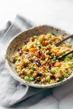 15 Minute Cauliflower Fried Rice - healthy + clean fried rice made with cauliflower, carrots, onions, garlic, eggs/tofu, and sesame oil! 180 calories per serving. Vegetarian / vegan / gluten free. | pinchofyum.com