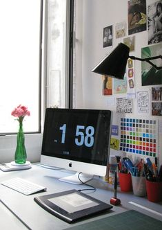 I love how every day this little office looks. Simple and pretty. Plus the iMac, keyboard and tablet are awesome!