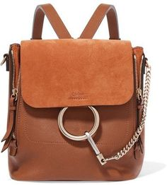 $1,850 - Chloé - Faye Small Leather And Suede Backpack - Brown - Sized to hold every fashion week essential like a camera, notebook and snacks, it's no surprise Chloé's 'Faye' backpack was an immediate hit with the influencers. This one is made from supple tan leather and has a suede top flap. It's detailed with the cult ring hardware and has zips to expand its shape even further