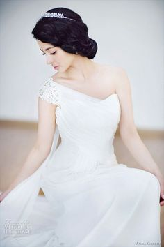 Anna Greeda Wedding Gowns Don't usually like one shoulder dresses, but with the hair it really balances