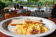 Scrambled eggs with ham and a toast on the side La Perla del Sur Restaurant Sierpe, Costa Rica #food #foodie #travel