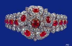 The Queen's County of Cornwal Ruby Bracelet This bracelet is one of the many jewels the Queen has inherited from her grandmother, Queen Mary. It is made of diamond and ruby leaf bands with a diamond and ruby rose centre; the rose is detachable and can be worn separately as a brooch or a pendant. Although popularly known as the Country of Cornwall Bracelet, there is some confusion about its provenance.