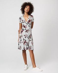 Floral Print Jersey Knit Wrap-Like Dress - From its wrap-like neckline to its playful skirt and pretty florals, this soft jersey dress is full of style.