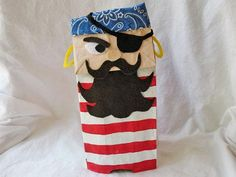 Paper Bag Pirate:    Arrgggh, swab the deck matey, and hoist the anchor! It's time to make some cute paper bag pirates and create your very own puppet show. Make this ornery little sailor for Halloween, and create a few more seamen (or even a parrot) to round out the crew!