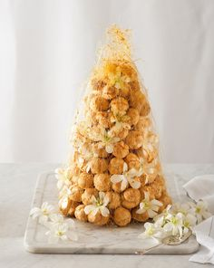 The Croquembouche is a spectacular French pastry creation that is served at special occasions. Its name is derived from the French words croquet en bouche, meaning 'crunch in the mouth'.