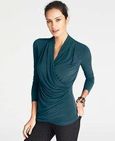 Pleated Jersey Wrap Top - Adorned with eye-catching (and endlessly slimming) pleats, this sensationally soft style is a beautifully versatile go-to. V-neck with crossover front. Long sleeves.