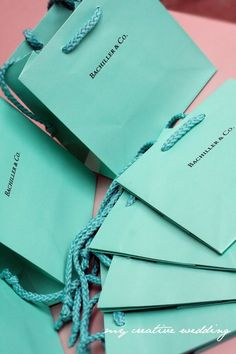 """These Tiffany & Co. inspired favor bags come foil printed with """"{your name) & Co."""" How perfect for party favors or specialty packaging with this color or Tiffany & Co. theme. Comes complete with a 6-1/2""""x 3-1/2"""" x 6-1/2"""" Tiffany colored shopping bag with Black Foil printing only. This listing is for 25 bags for $125.00 (which is $5 each) But if you would like to order in larger quantities there is a volume discount amount: 50 = $200 ($4 each) 100 = $350 ($3.50 each)"""