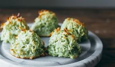 F&W--Matcha Coconut Macaroons Green tea powder adds a light, toasty flavor—and pretty green color—to this fast version of coconut macaroons. Tea Recipes, Wine Recipes, Sweet Recipes, Dessert Recipes, Cooking Recipes, Shake Recipes, Cooking Ideas, Yummy Recipes, Green Tea Dessert