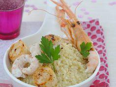 Découvrez la recette Risotto aux Saint-Jacques et langoustines sur cuisineactuelle.fr.
