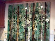 We created this custom fused glass backsplash for our client in Cornelius, North Carolina featuring native birch trees. It is comprised of three fused glass panels making up a mural with dimension...